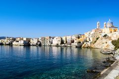 The island of Syros. Holidays on the island of Syros. The beach in the Vaporia district Royalty Free Stock Photo