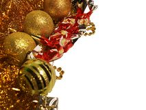 Holidays isolated background with gold tinsels, ball decorations, beadwork, christmas cand and small gift box. Stock Image