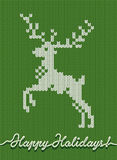 Holidays knitted card or background with a deer Stock Photography