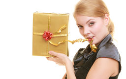 Holidays love and happiness concept - beautiful blonde girl with golden gift box Royalty Free Stock Image
