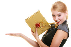 Holidays love happiness concept - girl with gift box. Holidays love and happiness concept - beautiful blonde girl with golden gift box open palm for your product Stock Images