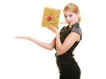 Holidays love happiness concept - girl with gift box. Holidays love and happiness concept - beautiful blonde girl with golden gift box open palm for your product Royalty Free Stock Photos