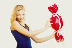 Holidays love happiness concept - girl with red gift Stock Photography
