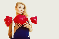 Holidays love happiness concept - girl with red gift Stock Images