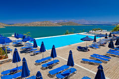 Holidays at Mirabello Bay in Greece. Blue swimming pool at Mirabello Bay in Greece Royalty Free Stock Photo