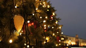 Holidays in Moscow. In the square a Christmas tree glows, decorated with balls and beautiful Christmas toys close-up. stock video