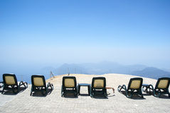 Holidays in the mountains. Chairs in the mountains. Rest and relaxation. Height, mountains and sky horizon Stock Photo
