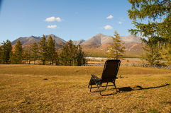 Holidays in the mountains. A chaise longue in a mountain valley stock images