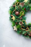 Advent christmas door wreath with festive decoration. Holidays new year concept. Advent christmas door wreath with festive decoration on a cozy background. Copy royalty free stock photography