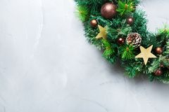 Advent christmas door wreath with festive decoration. Holidays new year concept. Advent christmas door wreath with festive decoration on a cozy background. Copy stock images