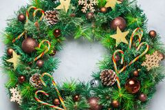 Advent christmas door wreath with festive decoration. Holidays new year concept. Advent christmas door wreath with festive decoration on a cozy background. Flat royalty free stock photo