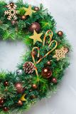 Advent christmas door wreath with festive decoration. Holidays new year concept. Advent christmas door wreath with festive decoration on a cozy background. Flat stock photography
