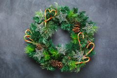 Advent christmas door wreath with festive decoration. Holidays new year concept. Advent christmas door wreath with festive decoration on a cozy black background royalty free stock images