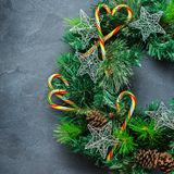 Advent christmas door wreath with festive decoration. Holidays new year concept. Advent christmas door wreath with festive decoration on a cozy black background stock images