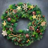 Advent christmas door wreath with festive decoration. Holidays new year concept. Advent christmas door wreath with festive decoration on a cozy black background stock photos