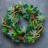 Advent christmas door wreath with festive decoration. Holidays new year concept. Advent christmas door wreath with festive decoration on a cozy black background stock photography