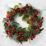 Advent christmas door wreath with festive decoration. Holidays new year concept. Advent christmas door wreath with festive decoration on a cozy white background royalty free stock images