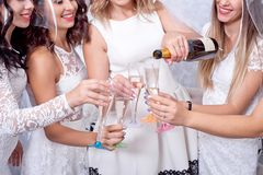 Holidays, nightlife, bachelorette party and people concept - smiling women with champagne glasses.  Royalty Free Stock Photo