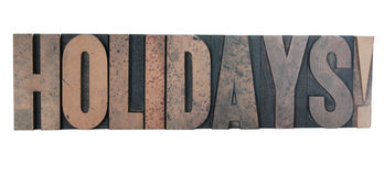 'holidays!' in old letterpress wood type. Old, ink-stained wood letters spell out the word 'holidays!' in all caps isolated on white Royalty Free Stock Photos