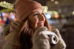 Happy young woman with camera at christmas Royalty Free Stock Photos