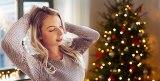 Happy young woman or teenage girl at home stock images