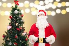 Santa claus at christmas tree Royalty Free Stock Photos