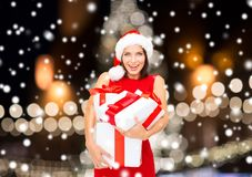 Smiling woman in santa hat with gift boxes Royalty Free Stock Photo