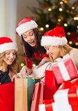 Women in santa hats with gifts on christmas royalty free stock image
