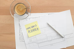 Holidays please written on a post-it Stock Photo
