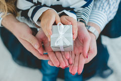 Holidays, present, christmas, childhood and happiness concep. Presents in child and mother's hand Stock Photo