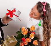 Holidays, presents, birthday concept - happy woman with flowers Stock Photography