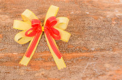Holidays ribbon. On wooden background Royalty Free Stock Photography