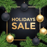 Holidays Sale gold text poster, golden Christmas tree ornaments Stock Images