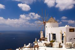 Holidays on Satorini. Greek island Santorini with its white and blue stock photography