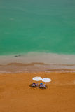 Holidays on the sea. Wo umbrellas and sunbeds on the beach vertical - dead sea, Israel Stock Photos