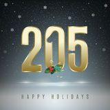 2015 holidays season. Happy holidays. Gold metal beveled numbers on dark grey background with snowflakes. Red holly berries used as color accent Stock Photography