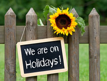 We are on holidays sign Stock Images
