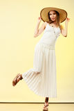 Woman in straw summer hat white dress Stock Photos