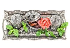 Holidays tea table setting with dates. Oriental hospitality. Ta table setting with dates, mint leaves and rose flower. Oriental hospitality concept Stock Images