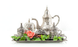 Holidays tea table setting with mint leaves and rose flower. Ori Stock Photos