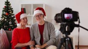Senior couple recording christmas video on camera stock video