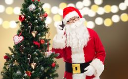 Santa claus calling on smartphone at christmas Stock Photo