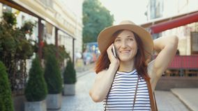Holidays and tourism - beautiful girl with phone, tourist book and vintage camera in the city. Holidays and tourism - beautiful red head girl with phone, tourist stock footage