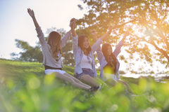 holidays and tourism, friendship concept - beautiful girls lay o Royalty Free Stock Photography