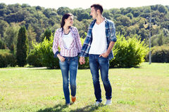 Holidays, vacation, love and friendship concept - smiling couple stock image