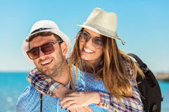Holidays, vacation, love and friendship concept - smiling couple having fun royalty free stock images