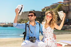Holidays, vacation, love and friendship concept - smiling couple having fun. Over sky background Stock Photo