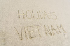 Holidays Vietnam written in sand. Holiday Vietnam written on the sand in Danang beach, Vietnam Stock Photos