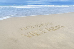 Holidays Vietnam written in sand. Holiday Vietnam written on the sand in Danang beach, Vietnam Royalty Free Stock Photos