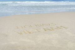 Holidays Vietnam written in sand. Holiday Vietnam written on the sand in Danang beach, Vietnam Stock Photo